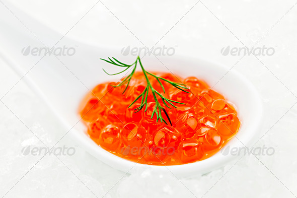 Caviar in spoon on ice - Stock Photo - Images