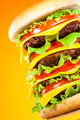 Tasty and appetizing hamburger on a yellow - PhotoDune Item for Sale