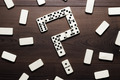 Domino Pieces Forming Question Mark On Wooden Table - PhotoDune Item for Sale