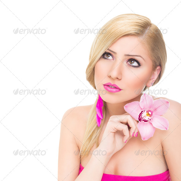 Gorgeous young blonde woman with pink orchid flower - Stock Photo - Images