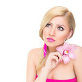 Gorgeous young blonde woman with pink orchid flower - PhotoDune Item for Sale
