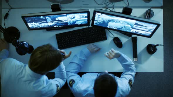 VideoHive Security Guard and His display Looking at Monitors with Video Surveillance Footage 19478702