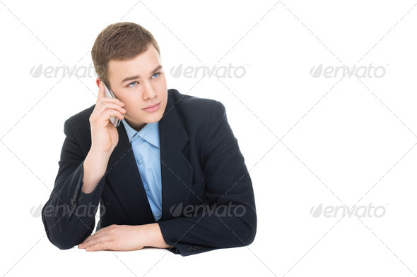 Young businessman speaking on smartphone - Stock Photo - Images