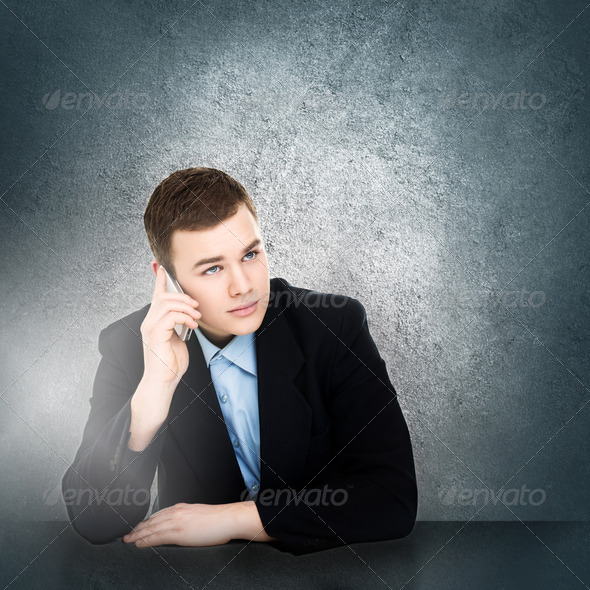 Modern young businessman talking on smartphone - Stock Photo - Images
