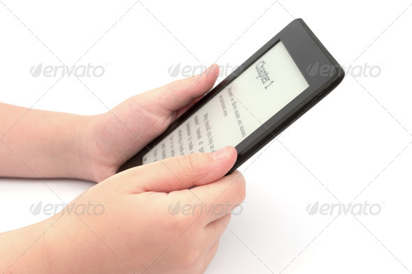 Holding E-book reader - Stock Photo - Images