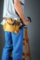 Contractor Standing on Ladder Holding Hammer - PhotoDune Item for Sale