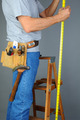 Contractor Standing on Ladder Measuring - PhotoDune Item for Sale