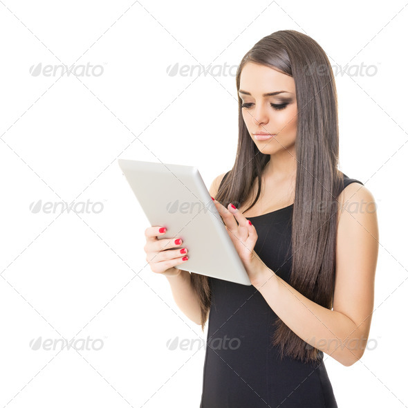 Elegant businesswoman using digital tablet - Stock Photo - Images