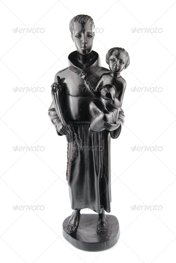 Blackwood statue of Saint Anthony and Jesus - Stock Photo - Images