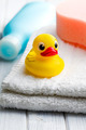 yellow bath duck on white towel - PhotoDune Item for Sale