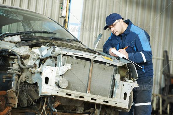 worker at car repair determination - Stock Photo - Images
