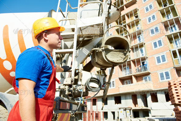builder worker at construction site - Stock Photo - Images