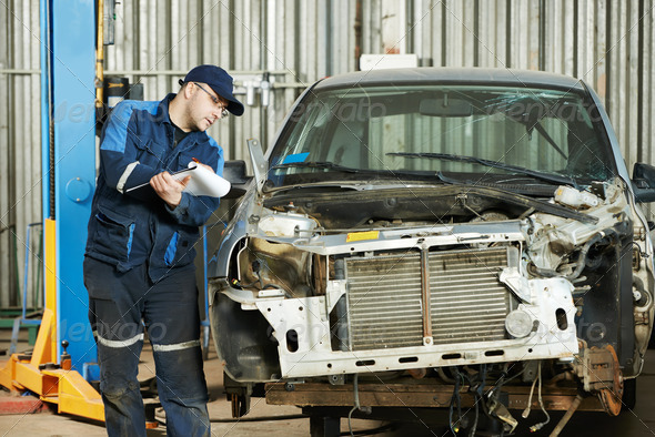 worker at car repair determination - Stock Photo - Images