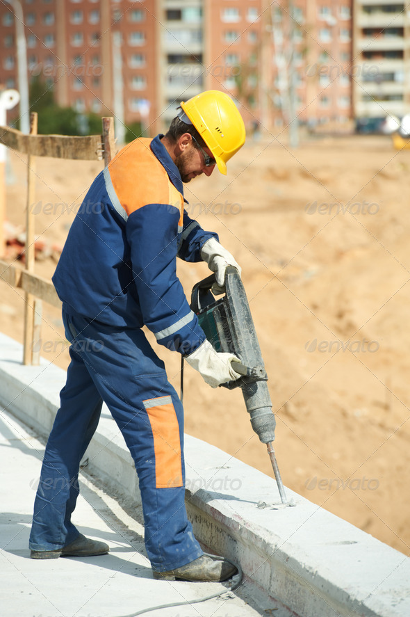 portrait of construction worker with perforator - Stock Photo - Images