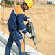 portrait of construction worker with perforator - PhotoDune Item for Sale