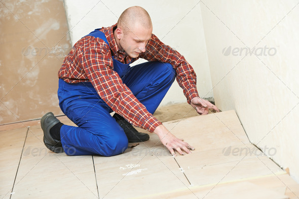 tiler at home floor tiling renovation work - Stock Photo - Images