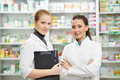 Two Pharmacy chemist women in drugstore - PhotoDune Item for Sale