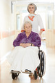 Nurse with elderly patient in wheelchair - PhotoDune Item for Sale