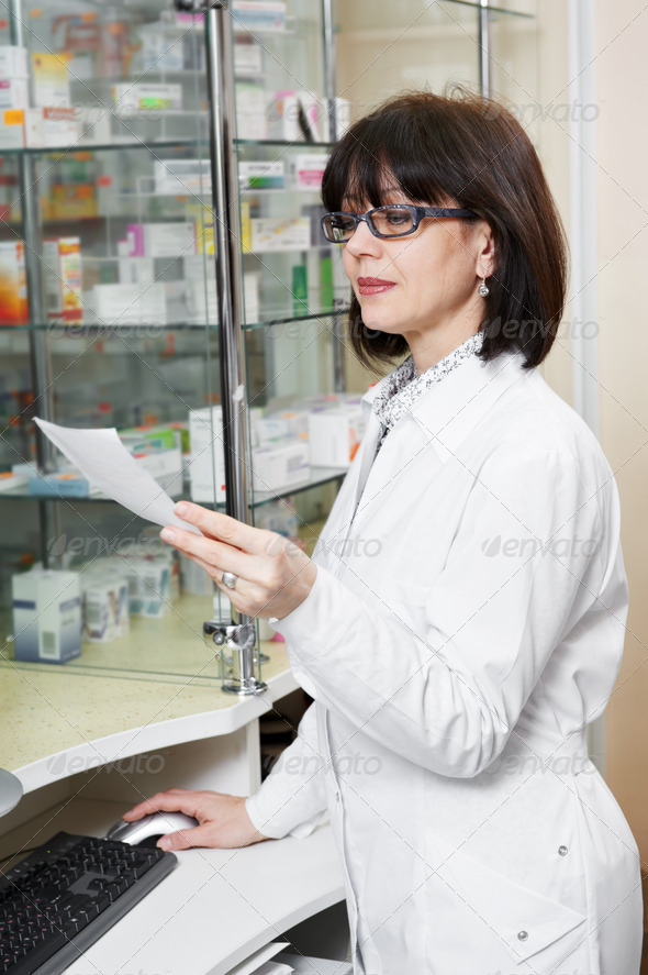 Pharmacy chemist woman in drugstore - Stock Photo - Images