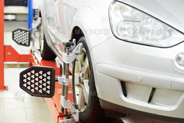 car at wheel alignment diagnostic tester - Stock Photo - Images