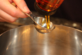 Syrup from Bottle being squeezed into Measuring Spoon - PhotoDune Item for Sale