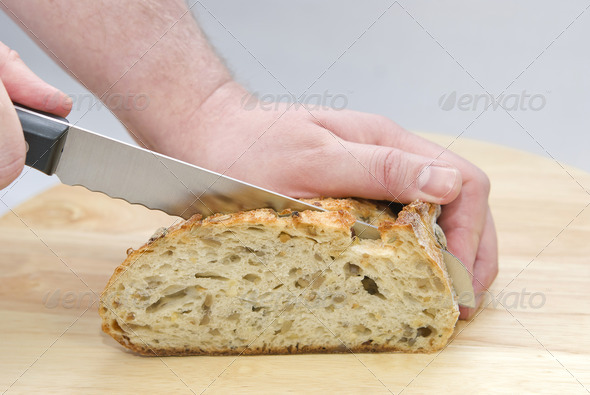 Cutting Bread - Stock Photo - Images