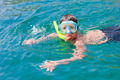 boy of ten in the mask and tube floats on the Black Sea - PhotoDune Item for Sale