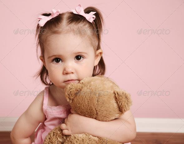 Beautiful girl and teddy bear
