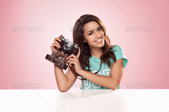 Beautiful woman with a vintage camera - Stock Photo - Images
