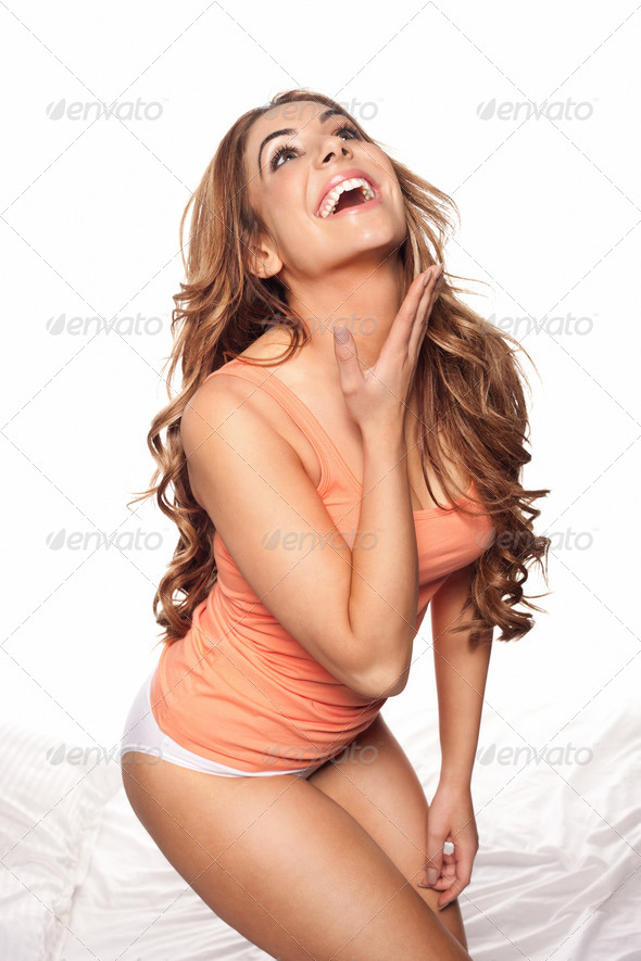 Laughing beautiful woman in lingerie - Stock Photo - Images