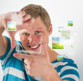 Young man making frame gesture with his fingers, virtual picture - PhotoDune Item for Sale