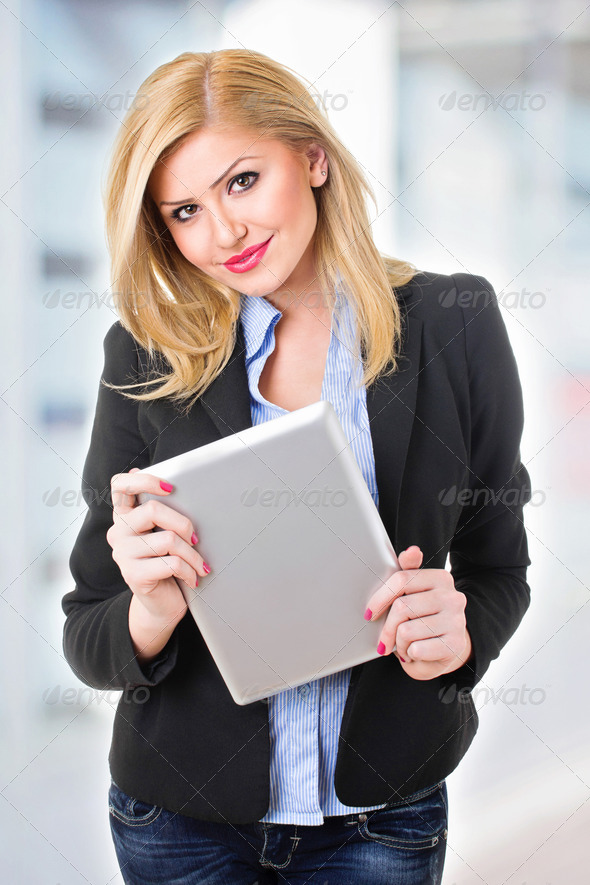Happy young woman with digital tablet - Stock Photo - Images