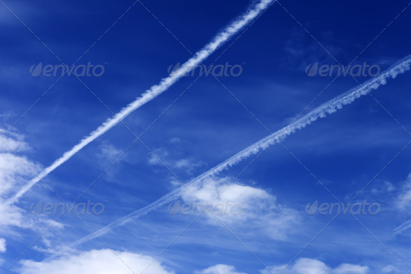 Blue sky with contrails - Stock Photo - Images