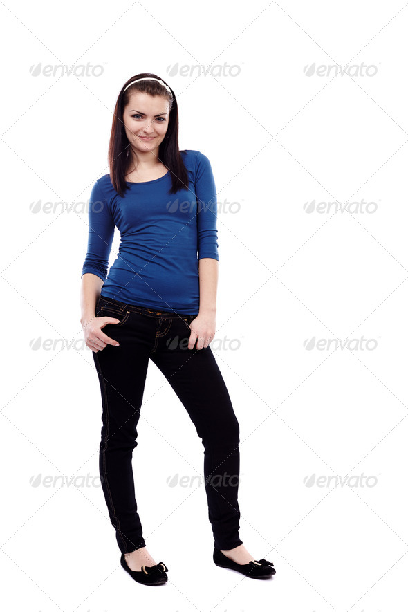 Young woman standing isolated on white background - Stock Photo - Images