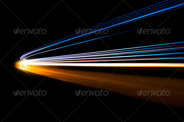 Abstract car lights in a tunnel in blue, yellow and orange - Stock Photo - Images