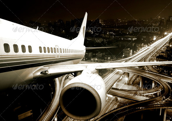 the airplane take off from the city night