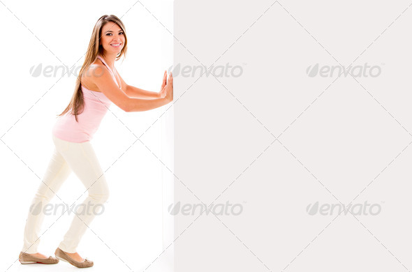 Woman pushing a wall - Stock Photo - Images