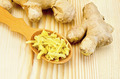 Ginger fresh grated in a wooden spoon - PhotoDune Item for Sale