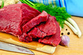 Meat beef on a wooden board with a knife - PhotoDune Item for Sale
