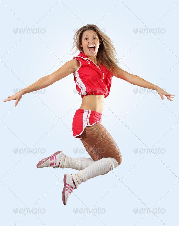 cheerleader girl jumping - Stock Photo - Images