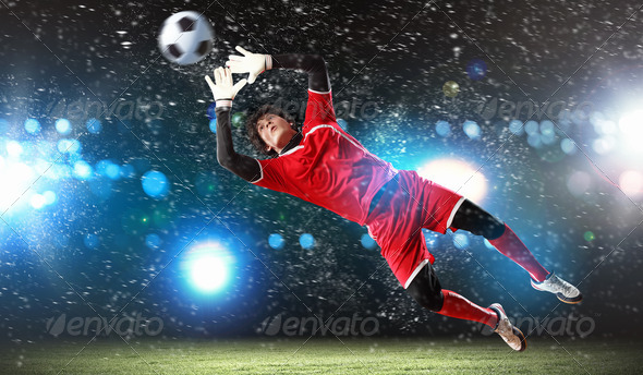 Goalkeeper catches the ball - Stock Photo - Images