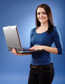 Young woman holding a laptop - PhotoDune Item for Sale
