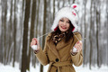 Beautiful woman wearing fur hat in the forest in the winter - PhotoDune Item for Sale
