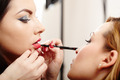 Woman having makeup applied by makeup artist - PhotoDune Item for Sale