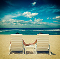 Couple in beach chairs holding hands near ocean - PhotoDune Item for Sale