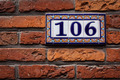 Decorated house number on brick wall in Europe. Bruges (Brugge), - PhotoDune Item for Sale