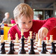 Young chess player at a tournament - PhotoDune Item for Sale