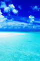 Empty beach with blue sky and vibrant ocean - PhotoDune Item for Sale