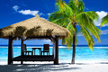 Tropical gazebo with chairs on amazing beach - PhotoDune Item for Sale