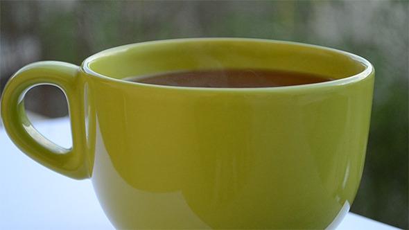 Hot Green Cup Of Tea